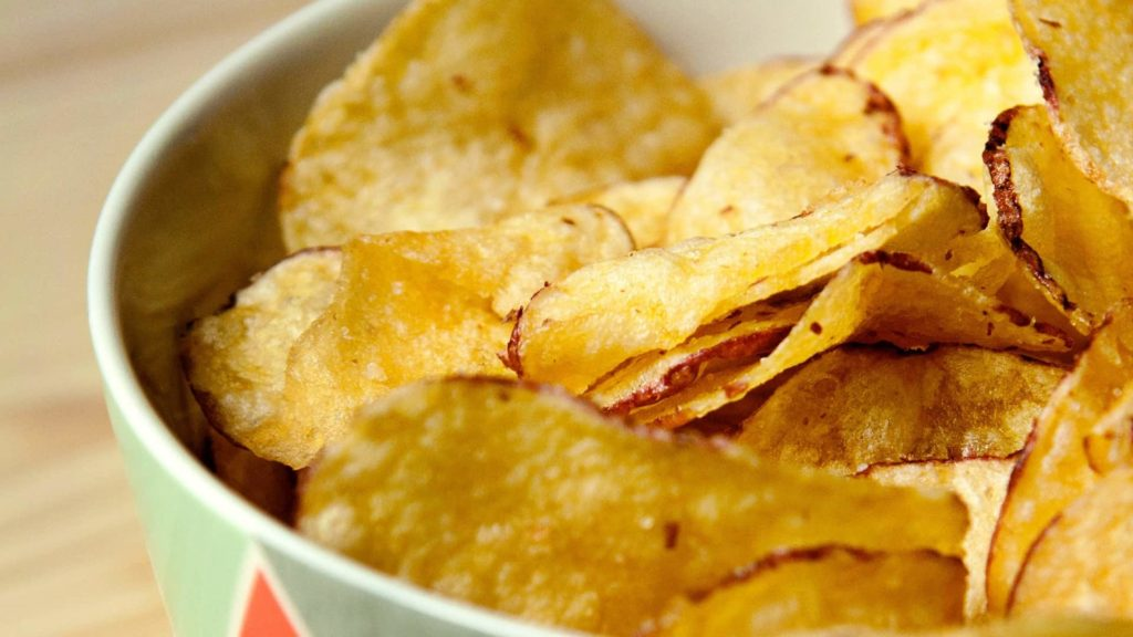 Potato chips sitting in a bowl