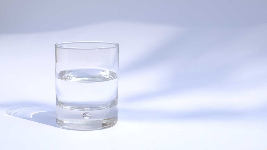 a cup of water resting on a table